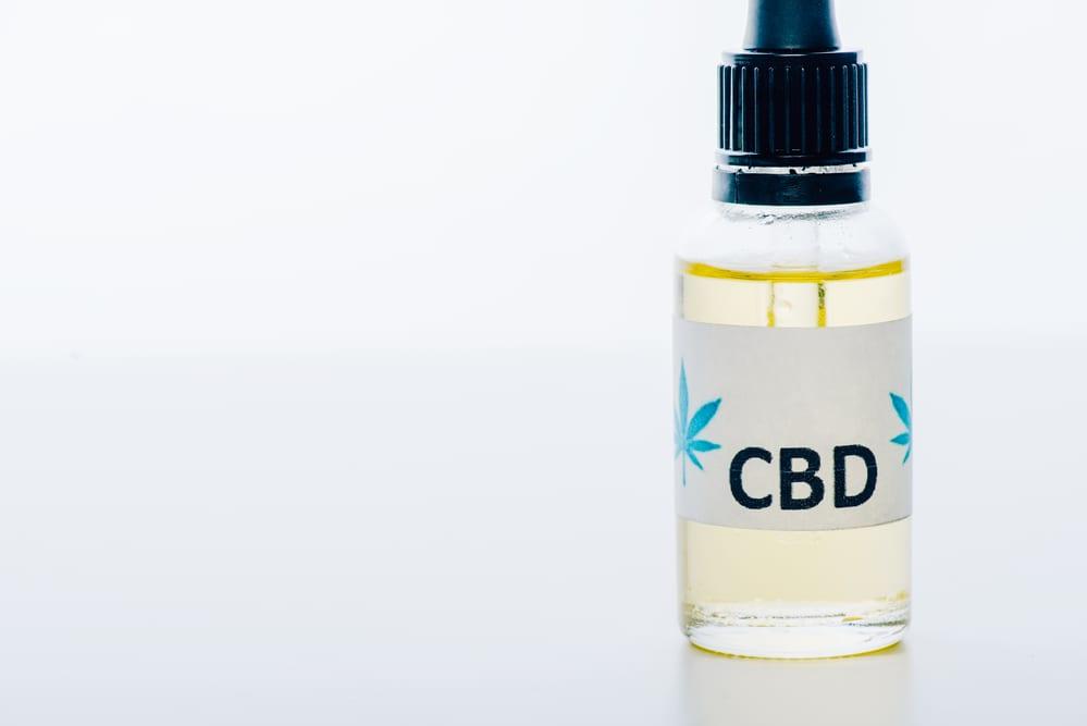 CBD oil in a jar to be used to make CBD Bath Bombs
